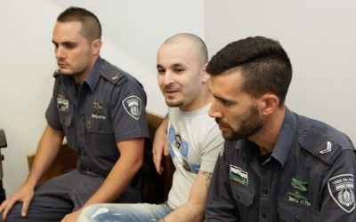 Tarlan Hankishayev, center, the former state witness in the 2009 shooting attack at the Bar Noar gay youth club in Tel Aviv, at the Tel Aviv District Court on May 20, 2015. (Roy Alima/Flash90)