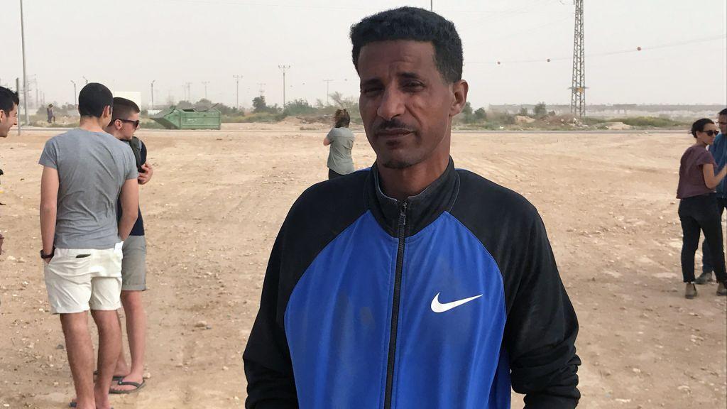 Hagos Takle, an asylum-seeker from Eritrea, outside the Holot detention facility, April 6, 2017. (Luke Tress/Times of Israel)