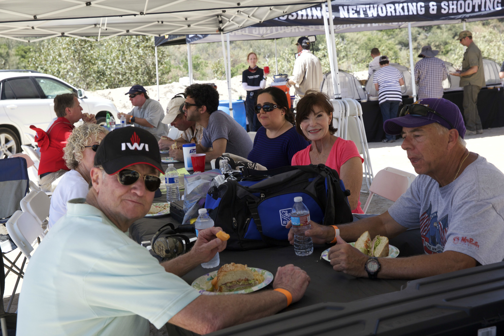 Participants enjoying the bagels at this gathering of Bullets & Bagels in the Los Angeles area. (Courtesy)
