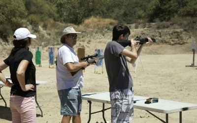 Participants engaging in target practice at Bullets & Bagels. (Courtesy)