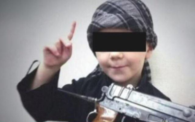 A young boy believed to be the eight-year-old son of Australian Islamic State fighter Khaled Sharrouf making threats against Australians in a home video. (Screen capture: YouTube)
