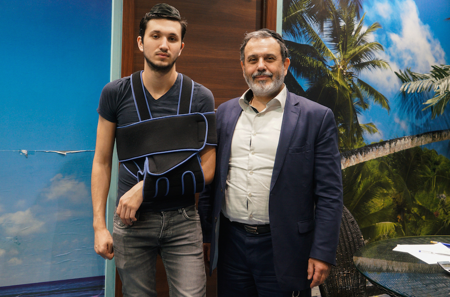 Netanel Azoulay, left, and his father, Armand, in Paris, March 14, 2017. (Cnaan Liphshiz/JTA)