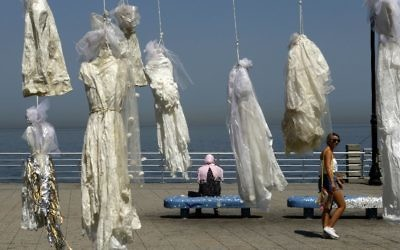 Lebanese activists use an installation of wedding dresses by Lebanese artist Mireille Honein at Beirut's Corniche to ramp up their campaign to press parliament to scrap Article 522 of Lebanon's penal code which allows rapists to escape punishement (AFP/Patrick Baz)