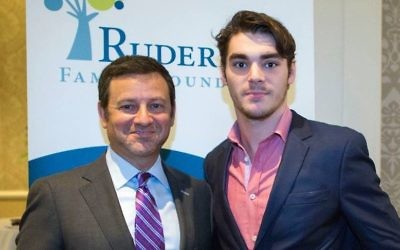 "Jay Ruderman, left, with R.J. Mitte, an actor with cerebral palsy who starred on the hit TV show ""Breaking Bad."" (Courtesy of the Ruderman Family Foundation via JTA)"