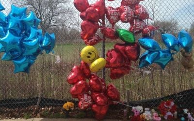 A makeshift memorial along a fence close to the spot where Robert Godwin Sr. was killed in Cleveland on Monday, April 17, 2017. Police said Steve Stephens killed Godwin on April 16, 2017, and posted the video on Facebook. (AP/Mike Householder)