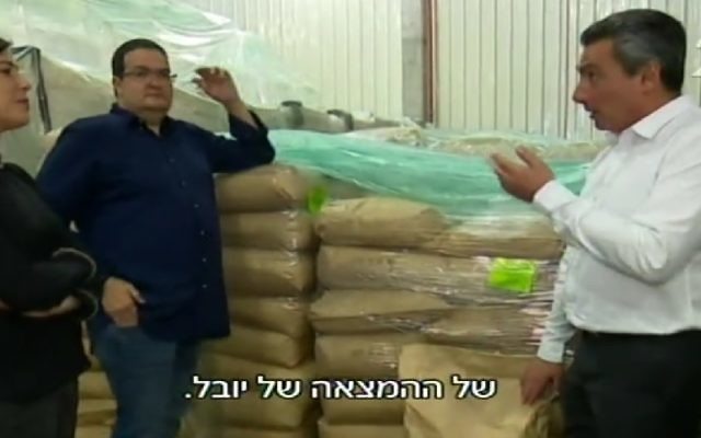 Sugat CEO, Gilles Gamon, right, with Unavoo founder Yuval Maimon, left, and a Channel 2 reporter examining newly arrived Unavoo packages. (Screenshot/Channel 2)