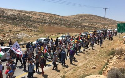 Some 250 Israeli and Palestinian activists march in the West Bank in a demonstration against settler violence on April 28, 2017. (Courtesy: Peace Now)