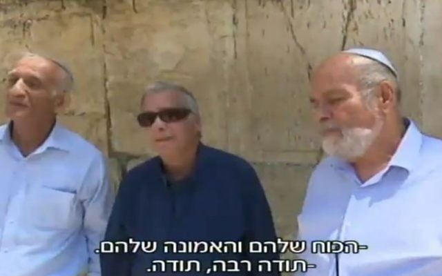 From L to R, Haim Oshri, Dr. Itizik Yifat and Zion Karasenti stand in front of the Western Wall in April 2017, nearly 50 years after the Six Day War battle to take the entire city. (screen capture: Channel 2)
