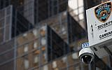 A New York City Police Department (NYPD) security camera hangs atop a light pole across the street from Trump Tower, March 7, 2017 in New York City. (Photo by Drew Angerer/Getty Images)