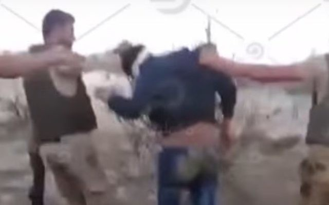 A screen capture from a clip showing Egyptian soldiers leading a blindfolded unarmed man. The man is seen shot to death from close range later in the clip, posted by an Egyptian opposition TV channel on Youtube on Thursday, April 20, 2017. (Screen capture YouTube)