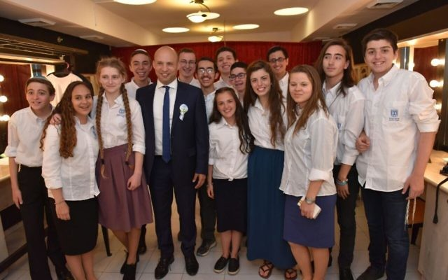 Sagiv Lugasi (c) winner of the annual Bible Quiz, with Prime Minister Benjamin Netanyahu (r) and Education Minister Naftali Bennett at the Jerusalem Theater, May 2, 2017 (Shlomi Amsalem)