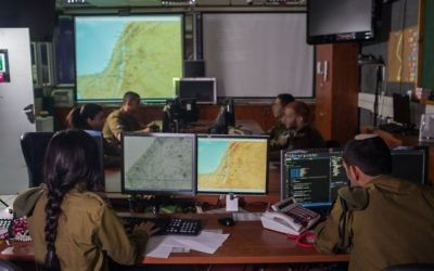 Illustrative. IDF soldiers from the C4I Corps work in a command and control center. (IDF Spokesperson's Unit)