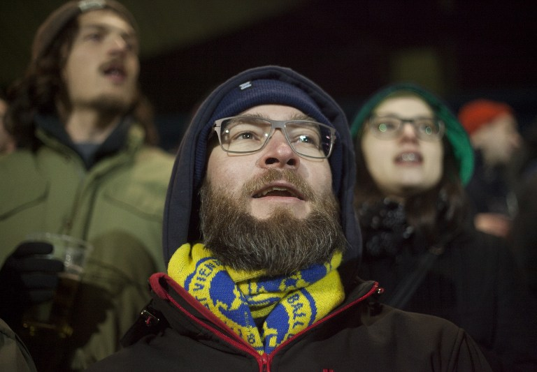 A fan of the First Vienna Football Club 1894 cheers during the regional League East game against Parndorf in the Hohe Warte stadium in Vienna, on March 10, 2017. (AFP PHOTO / ALEX HALADA)