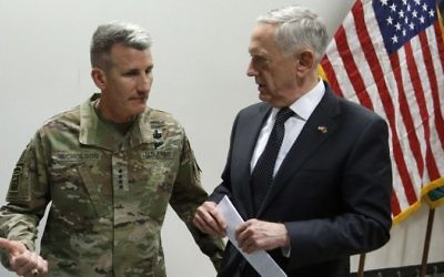 US Defense Secretary James Mattis, right, chats with US Army General John Nicholson, commander of US forces in Afghanistan, after a news conference at Resolute Support headquarters in Kabul, Afghanistan, April 24, 2017. (AFP/POOL/JONATHAN ERNST)