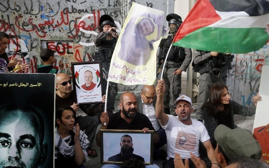 Palestinians protest in solidarity with security prisoners on a hunger strike in the West Bank city of Bethlehem on April 26, 2017. (AFP Photo/Musa Al Shaer)