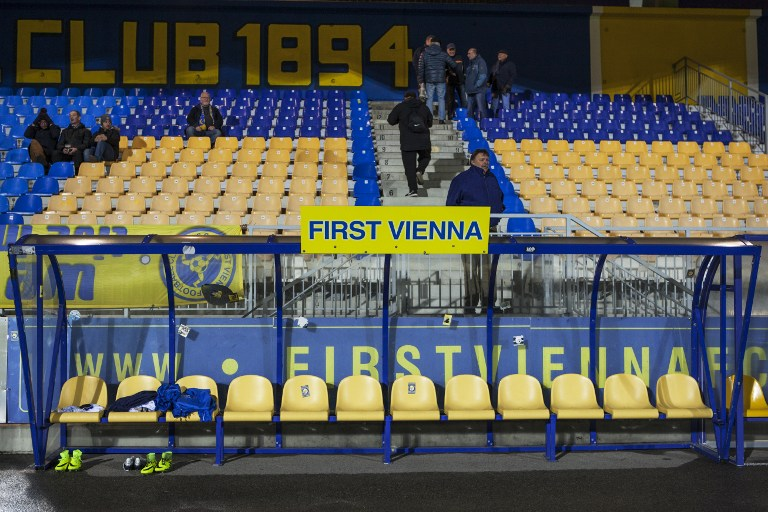 Fans and supporters of the First Vienna Football Club 1894 stadium are pictured during the regional League East game against Parndorf in the Hohe Warte stadium in Vienna, on March 10, 2017. AFP PHOTO / ALEX HALADA)