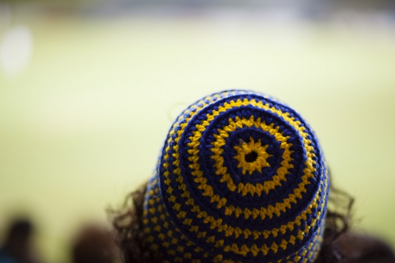 A fan with a hat in the colors of the First Vienna Football Club 1894, during the regional League East game against Parndorf in the Hohe Warte stadium in Vienna, March 10, 2017. (AFP PHOTO / ALEX HALADA)