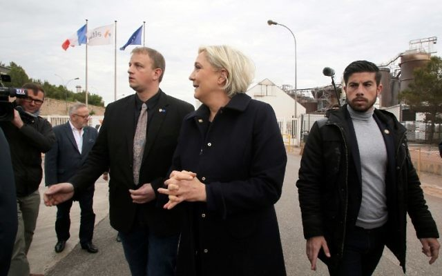French presidential election candidate for the far-right Front National (FN) party Marine Le Pen (L) arrives at the Alteo aluminium plant in Gardanne, southern France, on April 30, 2017. (AFP / STR)