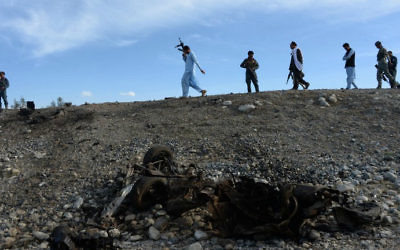 Afghan security forces inspect the site of a suicide attack targeting foreign troops in the Bati Kot district of Nangarhar province on May 1, 2017. (Noorullah Shirzada/AFP)