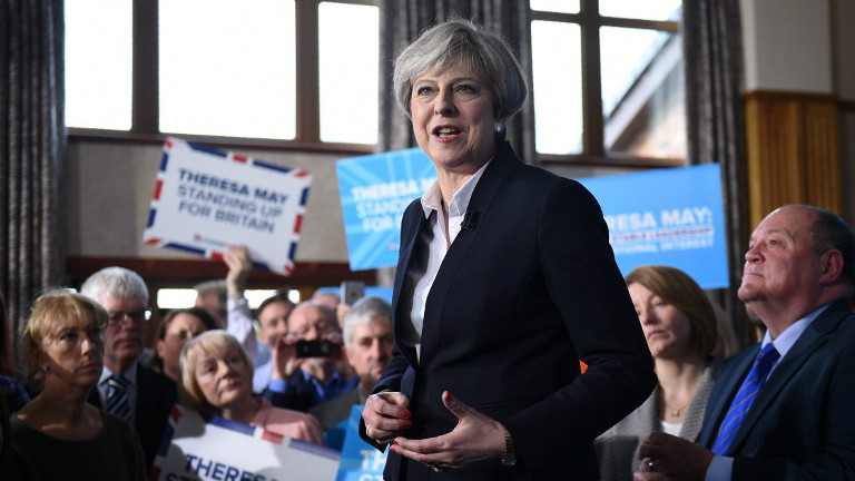 British Prime Minister Theresa May delivers a speech to Conservative Party supporters in Mawdesley Village Hall near Ormskirk, in north west England on May 1, 2017 as campaigning continues in the build up to the general election on June 8, 2017. (AFP/Oli Scarff)