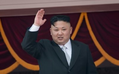 This file photo taken on April 15, 2017 shows North Korean leader Kim Jong-Un waving from a balcony of the Grand People's Study house following a military parade marking the 105th anniversary of the birth of late North Korean leader Kim Il-Sung, in Pyongyang. (AFP/Ed Jones)