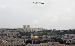 Israeli C-130 Hercules transport planes fly over Jerusalem during celebrations marking Israel's 69th Independence Day on May 2, 2017. (AFP Photo/Thomas Coex)