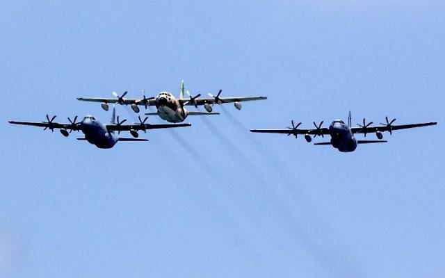 IAF Shimshon Hercules heavy transport planes seen over the beach in Tel Aviv during Israel's traditional Independence Day flyover on May 2, 2017. (AFP Photo/Jack Guez)
