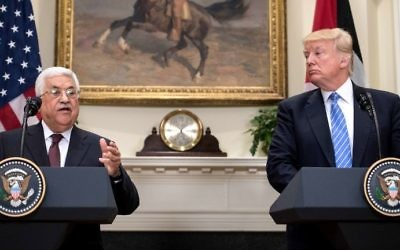 US President Donald Trump (right) and Palestinian Authority President Mahmoud Abbas speak in the Roosevelt Room during a joint statement at the White House on May 3, 2017. (AFP Photo/Nicholas Kamm)