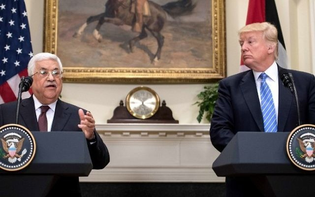 US President Donald Trump and Palestinian Authority President Mahmoud Abbas speak in the Roosevelt Room during a joint statement at the White House on May 3, 2017. (AFP Photo/Nicholas Kamm)