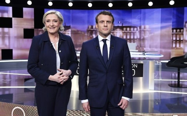 French presidential election candidates Marine Le Pen, left, and Emmanuel Macron pose prior to the start of a televised debate on May 3, 2017, as part of the second round election campaign. (AFP Photo/Pool/Eric Feferberg)