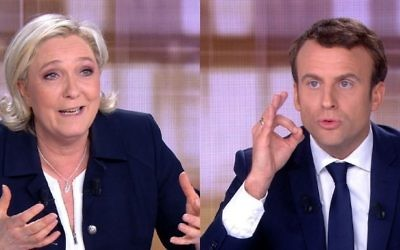 A combination of video grabs from an AFP video taken on May 3, 2017 during a live televised debate shows French presidential candidates Marine Le Pen, left, and Emmanuel Macron, right, ahead of the second round of the French presidential election on May 7, 2017. (AFP Photo/Stringer)