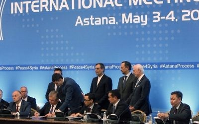 Russian mediator Alexander Lavrentiev, Iranian deputy foreign minister Hossein Jaberi Ansari, Kazakh Foreign Minister Kairat Abdrakhmanov and UN Special Envoy for Syria Staffan de Mistura attend the signing of a memorandum on creating safe zones in Syria during the fourth round of Syria peace talks in Astana on May 4, 2017. (Stanislav FILIPPOV / AFP)