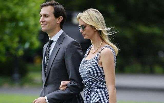 Jared Kushner and Ivanka Trump make their way across the South Lawn to board Marine One at the White House in Washington, DC on May 4, 2017. (AFP Photo/Mandel Ngan)