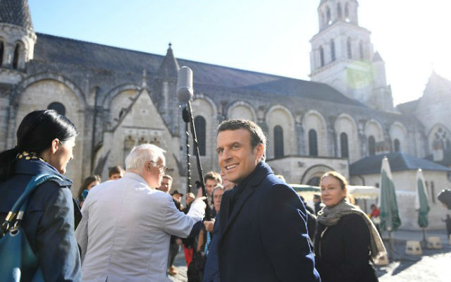 This file photo taken on April 29, 2017 in Poitiers, central France shows French presidential candidate Emmanuel Macron, center, campaigning ahead of the second and final round of the presidential elections on May 7, 2017. (Eric Feferberg/AFP)