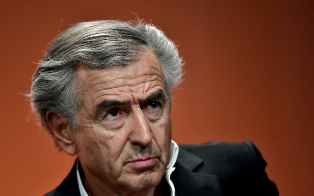 French philosopher Bernard-Henri Levy looks on during a forum against abstention in Paris, on May 5, 2017, two days ahead of the second round of the French presidential elections. (AFP PHOTO / PHILIPPE LOPEZ)