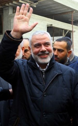 Hamas leader Ismail Haniyeh greeting supporters upon his return to Gaza City, after performing the Hajj pilgrimage, January 27, 2017. (AFP/MOHAMMED ABED)