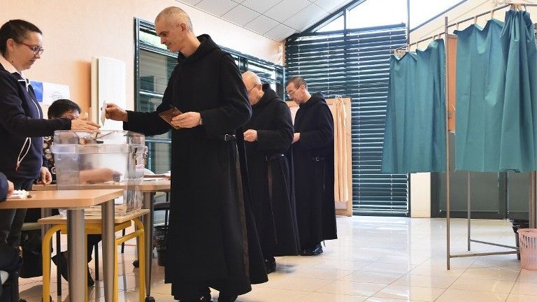 Benedictine monks cast their ballots in the second round of the French presidential elections, at a polling station in Solesmes, France, on May 7, 2017. (AFP Photo/Jean-Francois Monier)