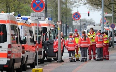 Ambulances are pictured on May 7, 2017, in Hanover, during the evacuation operation.  (AFP PHOTO / dpa / Peter Steffen)