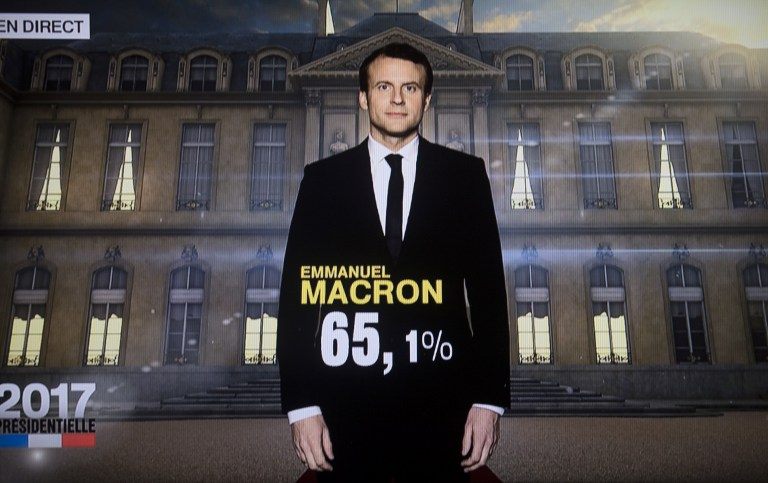 Screen capture of a TV screen displaying French President elected Emmanuel Macron with an estimated score of more than 65%, May 7, 2017. (AFP/OLIVIER MORIN)