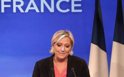 French presidential election candidate for the far-right Front National (FN) party Marine Le Pen delivers a speech in Paris, on May 7, 2017, after losing the second round of the French presidential election. (AFP PHOTO / joel SAGET)