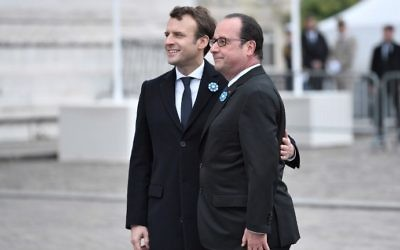 French President-elect Emmanuel Macron, left, and outgoing President Francois Hollande attend a ceremony to mark the end of World War II at the Arc de Triomphe in Paris, Monday, May 8, 2017. (AFP Photo/Pool/Stephane De Sakutin)