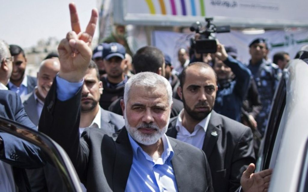 Newly elected Hamas chief, Ismail Haniya, flashes the V-sign after visiting protesters taking part in a sit-in in support of Palestinian hunger-striking prisoners held in Israeli jails, on May 8, 2017, in Gaza City. (AFP Photo/Mahmud Hams)