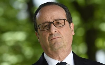 French President Francois Hollande seen at a ceremony marking the anniversary of the abolition of slavery on May 10, 2017, at the Jardins du Luxembourg. (AFP Photo/Pool and AFP Photo/Eric Feferberg)