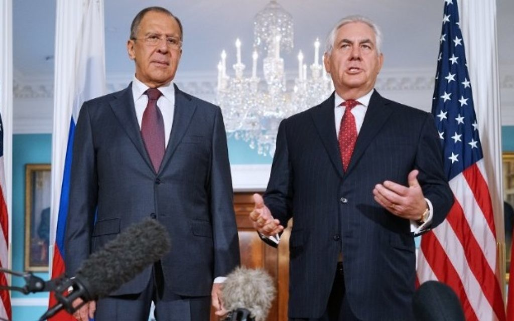 US Secretary of State Rex Tillerson (R) speaks while posing for photos with Russian Foreign Minister Sergei Lavrov in the Treaty Room of the State Department in Washington,  (AFP PHOTO / MANDEL NGAN)
