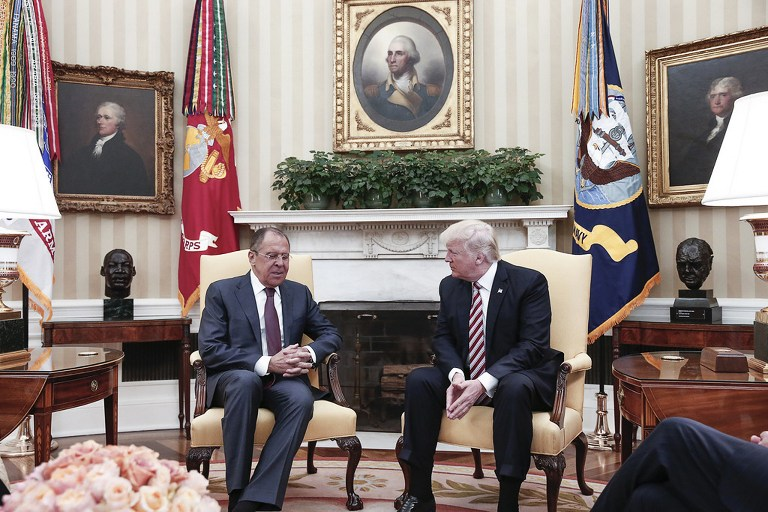 A handout photo made available by the Russian Foreign Ministry on May 10, 2017 shows US President Donald J. Trump (R) speaking with Russian Foreign Minister Sergei Lavrov during a meeting at the White House in Washington, DC. (AFP/Russian Foreign Ministry)