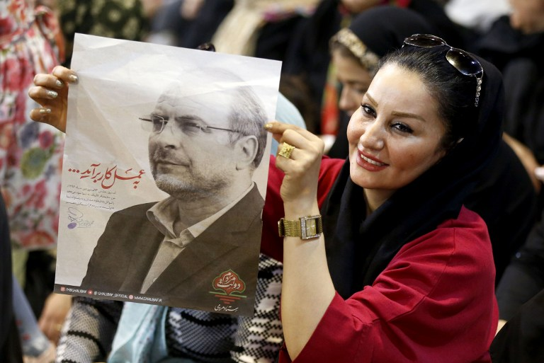 Supporters of Iranian conservative presidential candidate, Tehran mayor Mohammad Bagher Ghalibaf, hold his portrait during a campaign rally in the Iranian capital Tehran on May 11, 2017. (Atta Kenare/AFP)