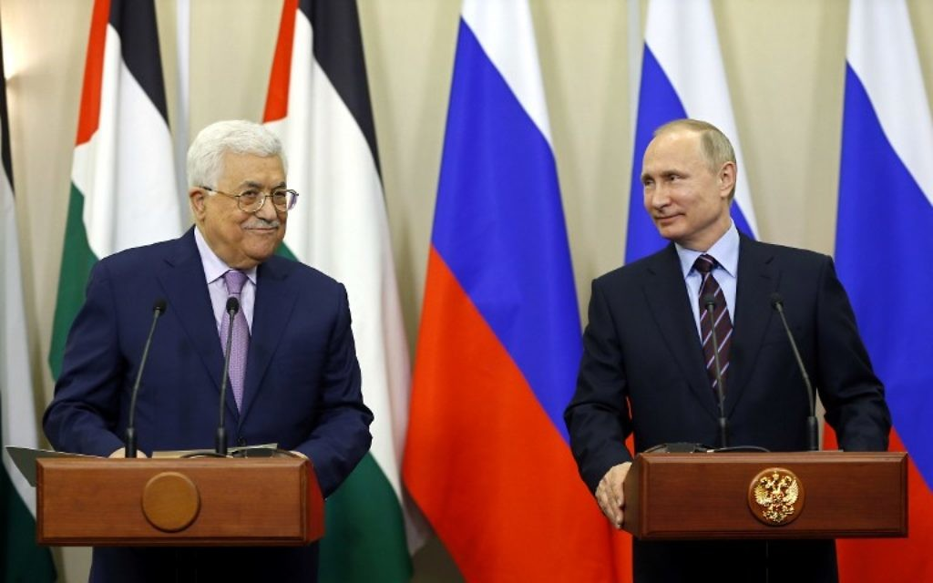 Russian President Vladimir Putin (R) and Palestinian leader Mahmoud Abbas take part in a videoconference with Bethlehem following a meeting at the Bocharov Ruchei residence in the Black Sea resort of Sochi on May 11, 2017. / AFP PHOTO / POOL / YURI KOCHETKOV