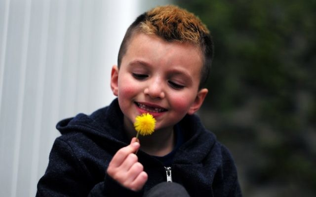 Seven-year-old transgender boy Jacob Lemay poses for photos in the yard of his home in Melrose, Massachusetts, on May 9, 2017. (JEWEL SAMAD / AFP)