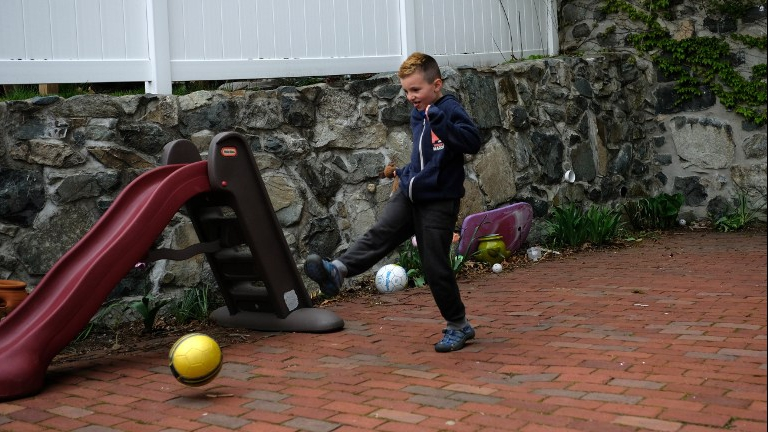 Seven-year-old transgender boy Jacob Lemay plays in the yard of his home in Melrose, Massachusetts, on May 9, 2017. (JEWEL SAMAD / AFP)