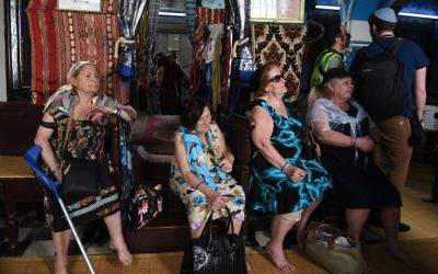 Four French-Tunisian sisters 79-year-old Fortunee (L), 87-year-old Henriette (CL), 82-year-old Eliane (CR) and 67-year-old Odette (R) visit the Ghriba synagogue in the Tunisian resort island of Djerba on May 12, 2017 as they participate in their annual pilgrimage to the synagogue on Tunisia's Mediterranean resort island of Djerba. (Fethi Belaid/AFP)